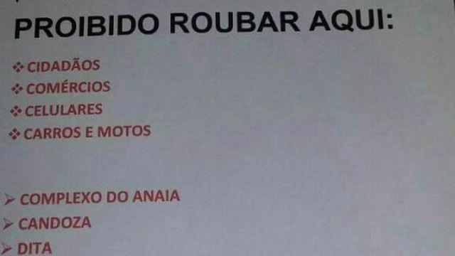Cartaz anti-roubo em favela de São Gonçalo, no Rio