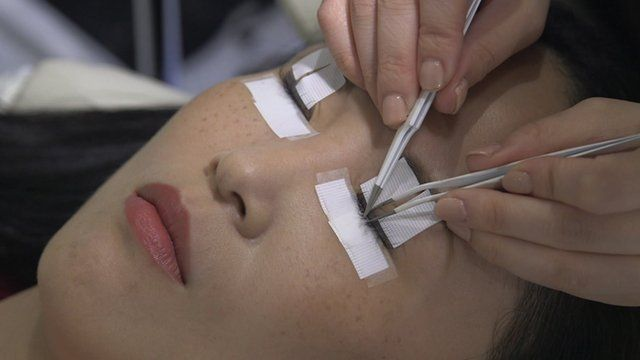 A woman getting eyelash extensions