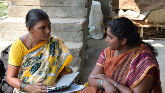 Health worker using app to screen for mental health disorders in rural India