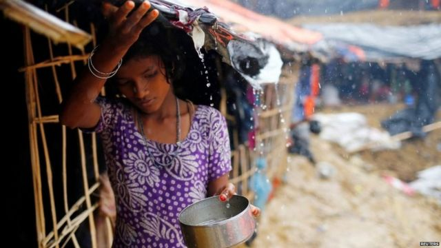 "A Rohingya refugee girl collects rain water at a makeshift camp in Cox""s Bazar, Bangladesh."
