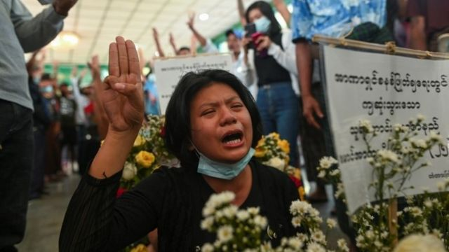 Woman at funeral of victims