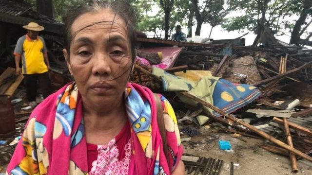 Rani beside her destroyed beachside stall in Anyer