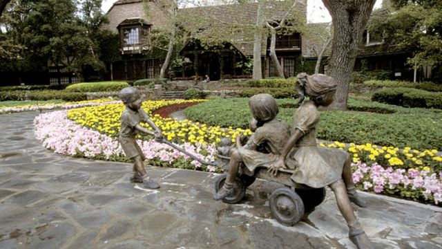 Exterior views of the entrance, house, statues and gardens at Michael Jackson's Neverland Ranch in 1995