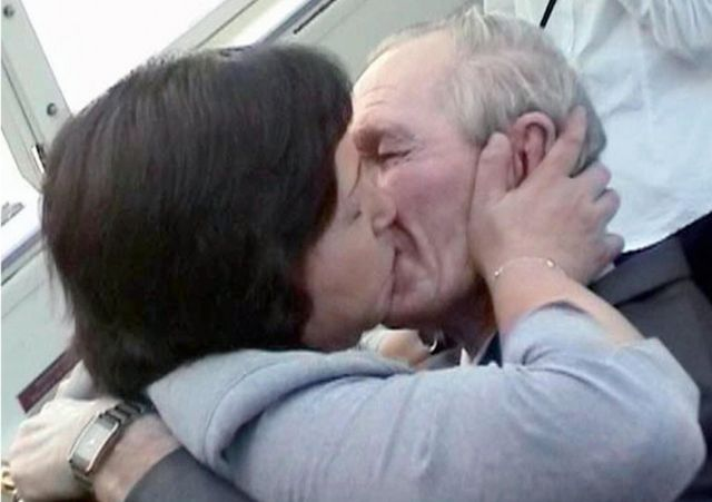 An emotional Hitomi Soga kisses her husband Charles Jenkins at Jakarta airport, on 9 July 2004.