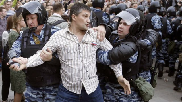 Police detain a participant of an unauthorised opposition rally in Tverskaya Street in central Moscow, Russia, 12 June 2017