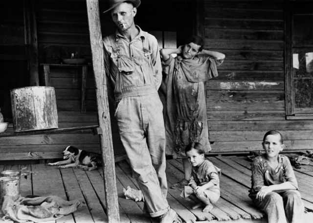 A family on their porch during the American depression.