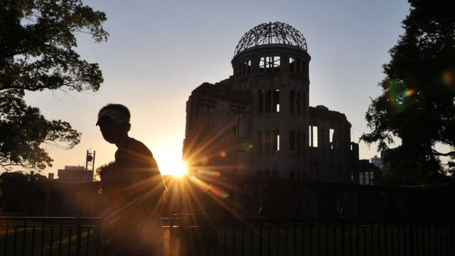 A man carries a boy past the the Hiroshima Atomic Dome (file image)