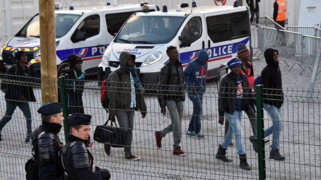 unaccompanied minors arrive to board a bus