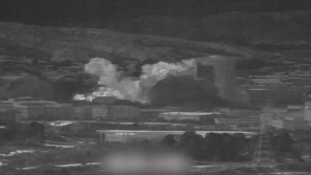 韩国国防部提供的照片显示,开城里联络办公室所在地满布浓烟。