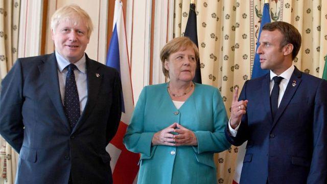 Boris Johnson, German Chancellor Angela Merkel and French President Emmanuel Macron