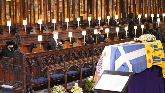 Queen Elizabeth II looks at the coffin of her husband the Duke of Edinburgh at St George's Chapel