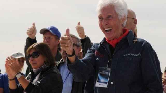 Wally Funk making a celebratory gesture