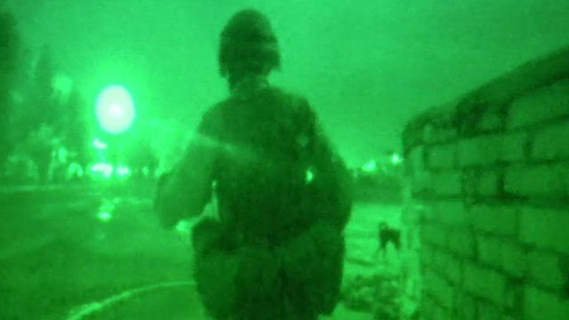 A soldier on night patrol in Basra, 2003