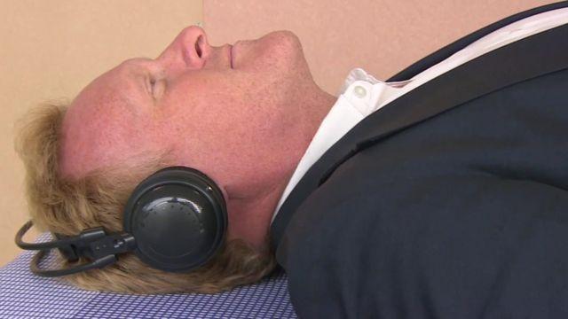 BBC Journalist John Maguire relaxing with earphones on