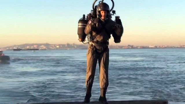 A man flying a jet pack