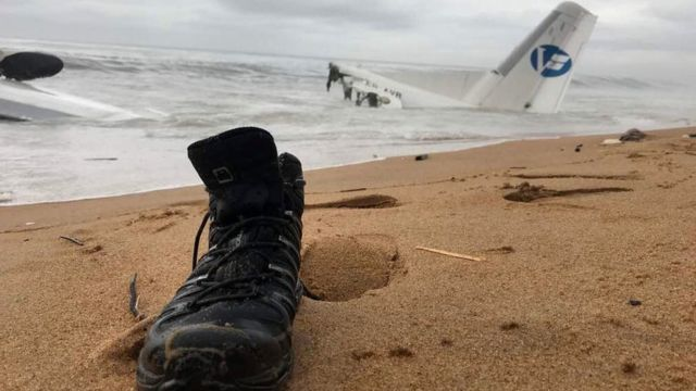 A boot on the beach near the plane's wreckage in the sea off Abidjan, Ivory Coast, 14 October