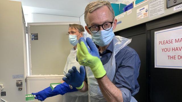 The BBC's Fergus Walsh with a vial of the vaccine