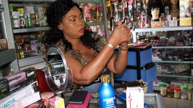 Woman wey dey rub bleaching cream.