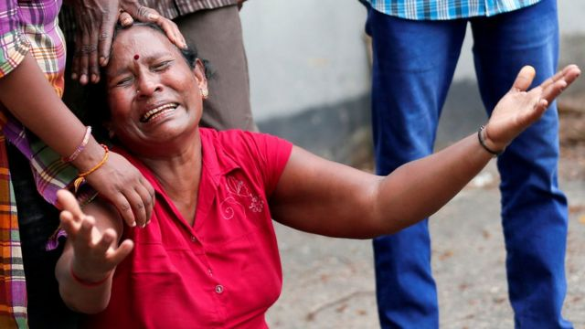 """A relative of a victim of the explosion at St. Anthony""""s Shrine, Kochchikade church, reacts at the police mortuary in Colombo"""