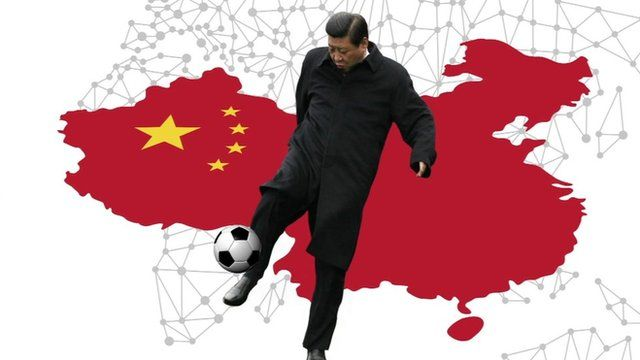 China's President Xi Jinping kicking a ball