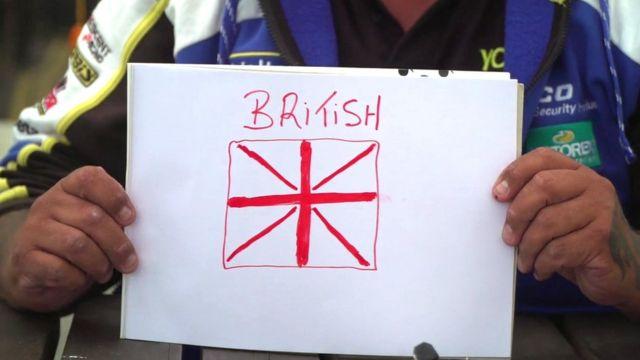 "Man with drawing saying ""British"""