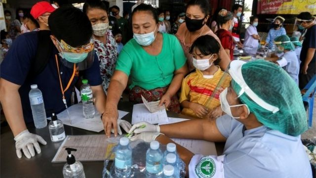 Migrant workers of a seafood market are seen before being tested, amid the coronavirus disease (COVID-19) outbreak, at a seafood market, in Samut Sakhon province, in Thailand, December 19, 2020