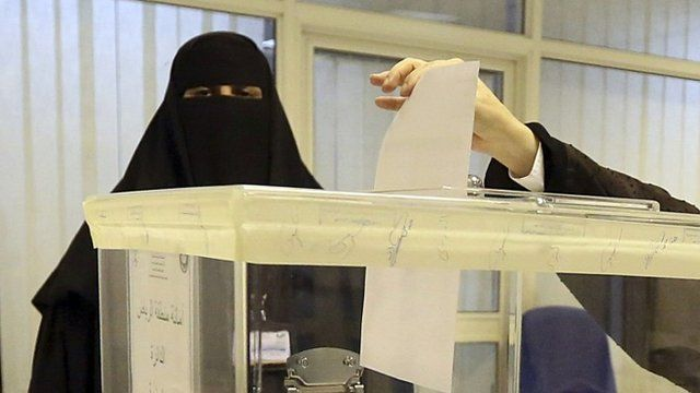 Woman at polling station in Saudi Arabia