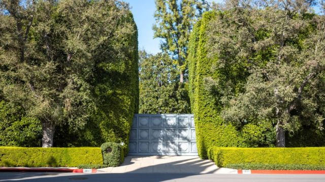 The gate of a mansion in Beverly Hills.