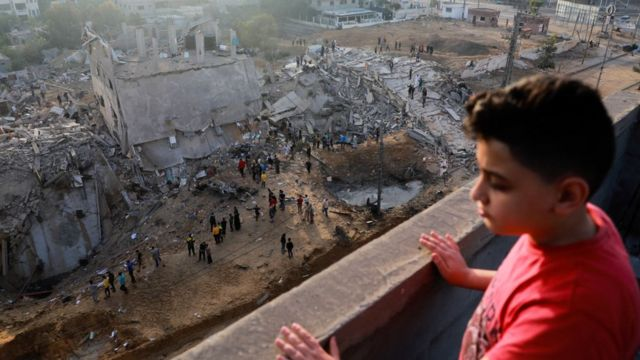 Palestinian boy watching destruction in Gaza.