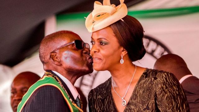 President Robert Mugabe kisses his wife and first lady Grace Mugabe during during the country's 37th Independence Day celebrations at the National Sports Stadium in Harare April 18, 2017.