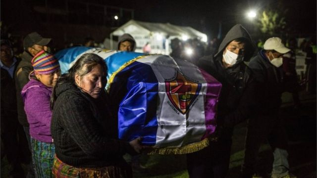 Family and friends with a coffin of the murdered migrants.  Comitancillo, Guatemala, March 12, 2021.