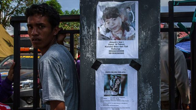 Photographs of missing people were displayed on the wall