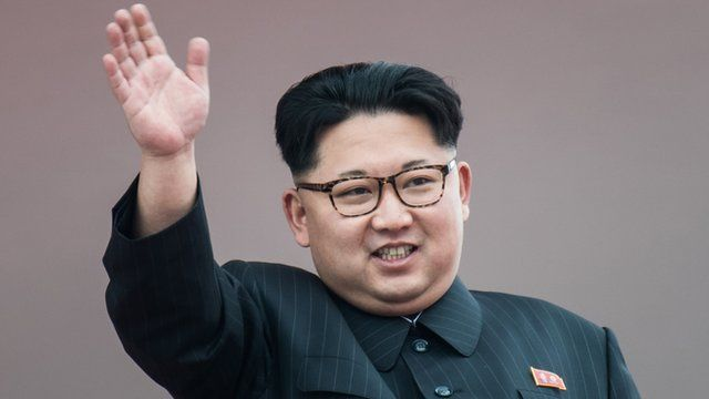 North Korean leader Kim Jong-Un waves from a balcony following a mass parade marking the end of the Party Congress on 10 May, 2016.