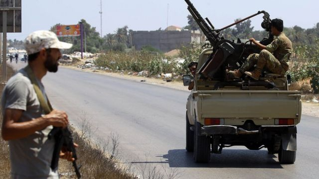 Libyan security forces patrol a checkpoint east of Tripoli, 23 August 2018