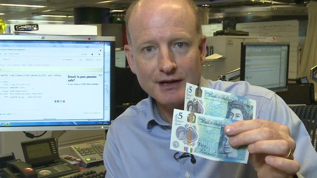 Simon Gompertz with the new £5 notes