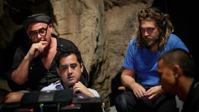 Writer/director Tom Waller on the set of 'THE CAVE' with cave rescue diver Erik Brown on location in Thailand