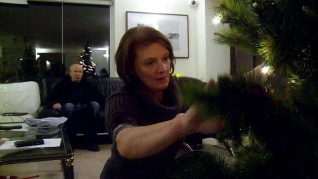 Chris Roberts watching his wife Jayne decorate the Christmas tree
