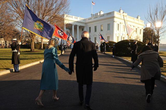President Joe Biden and First Lady Dr Jill Biden walk up to the White House