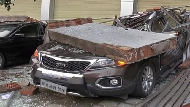 car crushed under large block