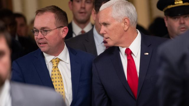 US Vice President Mike Pence and Mick Mulvaney walk between meetings