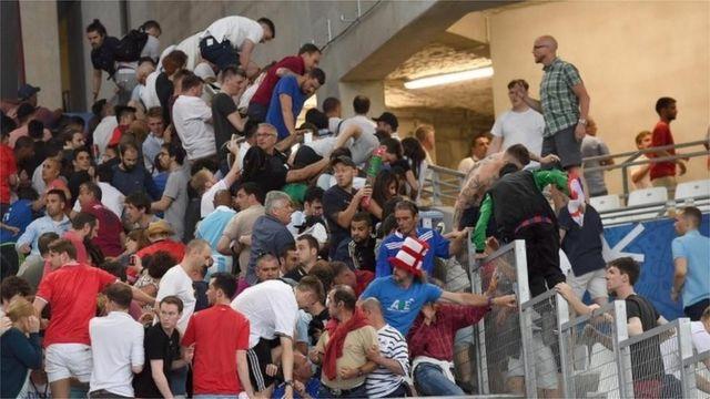 Fans in Marseille stadium climb fences to escape trouble