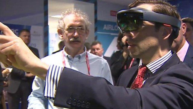 Ken Skates trying virtual reality technology on Deeside