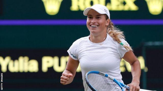 Yulia Putintseva celebrates beating Naomi Osaka in the first round of Wimbledon