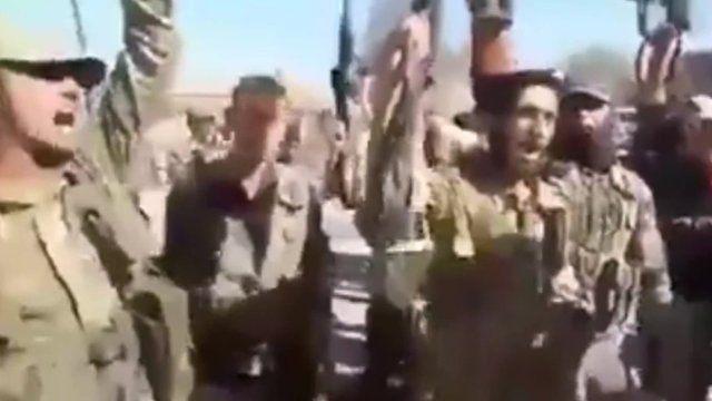 Rebels chanting in Al-Rai