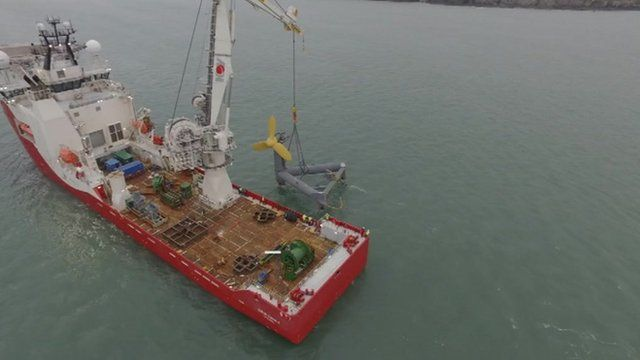 The turbine is lowered into the sea by an offshore construction vessel