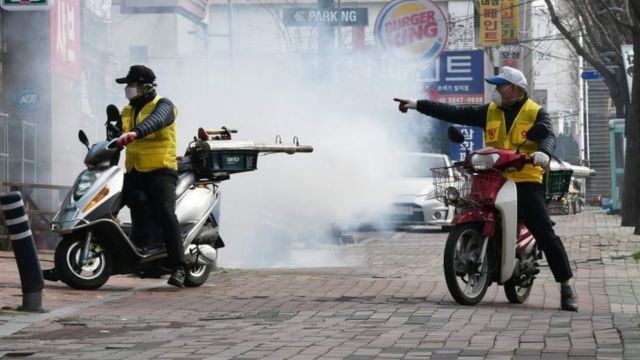 Workers on scooters disinfect the streets of Daegu, South Korea. Photo: 21 February 2020