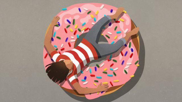 رسم تعبيري لشخص يستلقي على كعكة