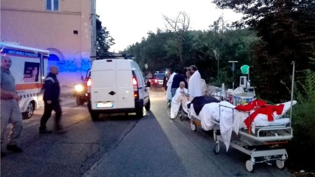 First aid is provided to people who were injured in an earthquake at a hospital in Amatrice