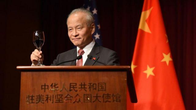 Chinese ambassador - shown at podium