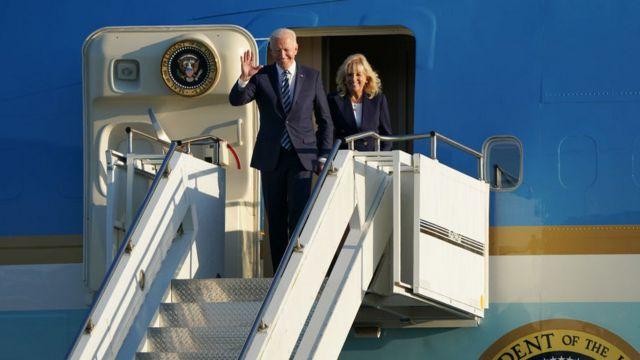 Joe Biden waves after landing in the UK
